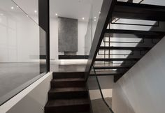 Contemporary walnut timber thread staircase with metal string. Polished concrete floor and polished plaster fireplace in the background Polished Plaster, Polished Concrete, Walnut Timber, Architects London, Earls Court, Residential Architect, Concrete Floors, New Homes, Stairs