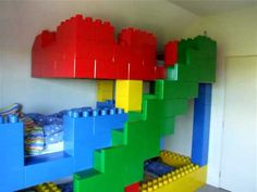 Incredible hand crafted Lego bunk beds for 3 kids. Amazing.
