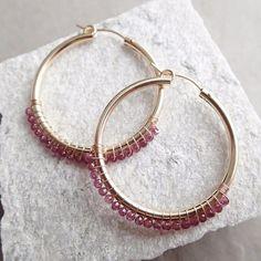 Garnet hoop earring