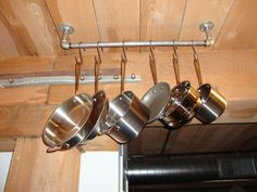 simple ceiling mounted pot rack over island!