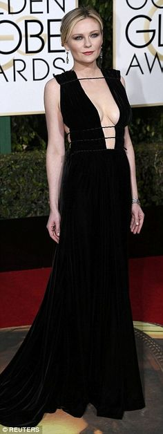 Confident: Fargo star and nominee Kirsten Dunst flashed the flesh in a plunging black dress by Valentino
