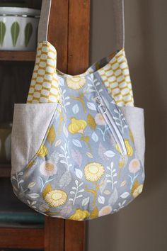 This tote is a fabric lovers favorite! Using small cuts of fabric, you'll be able to use your favorites and still have scraps leftover. It's called the 241 because it's like 2 patterns in one! One version of the bag has two exterior side pockets (great for beginners), the other has two exterior zippered pockets …                                                                                                                                                                                 More