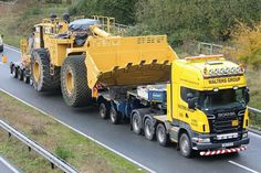 Caterpillar 992G and twin steer truck utilizing jeep dolly.