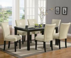 The Carter 7 Piece Dining Set by Coaster Furniture by Coaster Home Furnishings. $792.45. The Carter Dining Table by Coaster Furniture features a faux marble table top which looks and feels luxurious. The soft round edges, cream colored center inlay, and dark warm brown wood legs, complete the look. When paired with the sophisticated faux leather parson chairs, this dining set will give your semi-formal dining room a chic look that you will love. The chairs are available in eith...