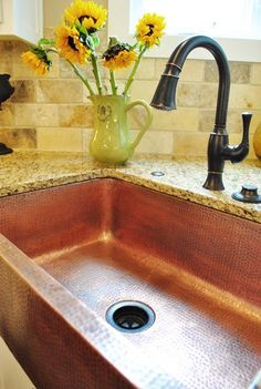 Copper sink is gorgeous, love the faucet, too!