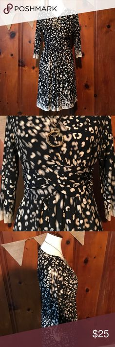 Chicos Dress!  Stylish and timeless!  Size 1. Faux wrap Dress that will beautifully accent your waistline.  Mesmerizing design that will be perfect for day or night!  Size 1.  No notable condition issues. Chico's Dresses Midi
