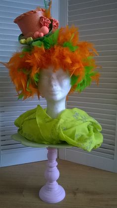 Orangegreen party had. Foam wig with mini hat on hairband, made by Lady Mallemour