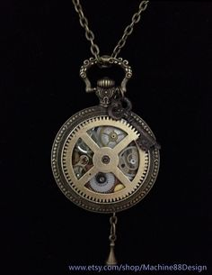 Steampunk pocketwatch pendant necklace with hand-placed vintage watch gears, victorian key charm, and gold vintage clock gear face.