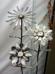 Found this on Facebook and thought it was a great idea to make. Can put them outside in your garden. Made from Old Forks and Spoons. I think welded onto rebar poles. Just don't know what is in the center of the flowers.