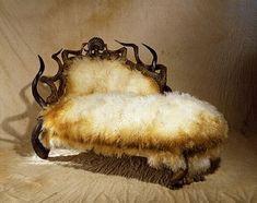 A chaise in Cruella DeVille's mansion