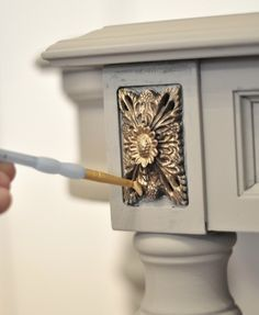 Kate used Rub n Buff to dry brush gold on a carved area on a console {Centsational Girl} Paint It Monday