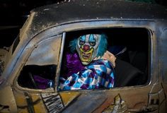 A man dressed up as a clown drives a car during the Halloween night on October 31, 2012 in Mexico city. (RONALDO SCHEMIDT/AFP/Getty Images)