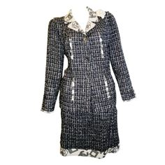 Chanel Runway skirt suit with Camelia pin   From a collection of rare vintage suits, outfits and ensembles at http://www.1stdibs.com/clothing/suits-outfits-ensembles/
