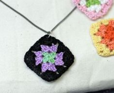 Tiny Granny Square Necklace from @Heather Mann: Dollar Store Crafts - Love free crochet patterns? Crocheted jewelry has never looked so good!