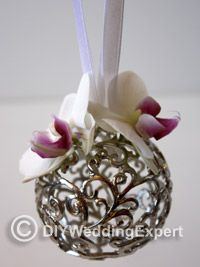DIY Orchid Wedding Pomander Ball--heck, I like this with fake flowers for simple room decorations or party decor