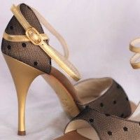 "Comme il Faut  Golden satin with black dotted tulle overlay. Open toe, gold wraparound straps and a 3,5"" brushed gold stiletto heel."