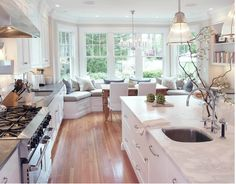 layout similar to what I am thinking for my kitchen. May need to move sink to island, like stove placement, great bench dining area.