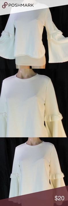 """Candies Cream Cropped Sweat Shirt Bell Sleeves M Candie's off white/cream knit cropped sweat shirt type material top. Over sized. Crew neck, shorter length with rolled raw hem edge. Long sleeves with a ruffle mid arm and bell sleeves.  Tag removed cotton or cotton blend, Machine wash.  Size/Measurements:  Marked/tagged size M Medium      Chest (underarm to underarm x2) 40""""     Length (back center neck seam to end) 22""""  Condition:    Excellent previously owned, no issues noted! Candie's Tops…"""