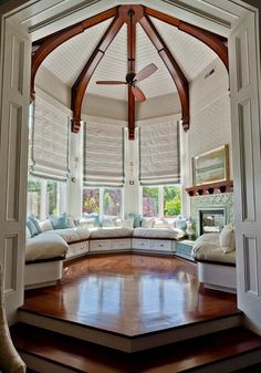 Sun Room - Built in bench, Fireplace, Exposed beams, Window Shades, Beautiful wood floor, Step up. - PERFECT.