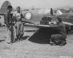 Ground crew checking the radio of a P-40 Warhawk fighter at a US 14th Air Force Base in China, May 1945; note Chinese Air Force roundel