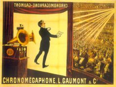 """Illustration of a theater from the rear right of the stage. At the front of the stage a screen hangs down with the projected image of a tuxedoed man holding up a text and performing. In the foreground is a gramophone with two horns. In the background, a large audience is seated at orchestra level and on several balconies. The words """"Chronomégaphone"""" and """"Gaumont"""" appear at both the bottom of the illustration and, in reverse, at the top of the projection screen."""