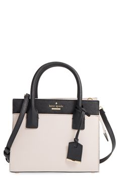 So precious! This mini satchel from Kate Spade features clean color blocking, painted edges and a crosshatched leather composition.