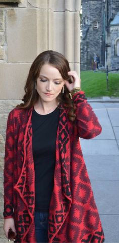 Fall weather is here, so I'm wearing my favorite red sweater from Lucky Brand Jeans. This outfit is perfect for everyday wear. It's very comfortable, but has a lot of style and flare. Super cute Aztec print sweater, Articles of Society skinny jeans, black