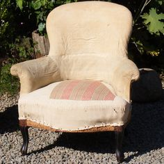 Spoon back chair covered in calico. Height: 81cm Width: 70cm Depth in seat: 50cm