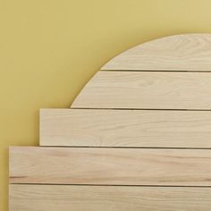 use basic tools and skills to create a stylish hardwood headboard to fit any bed width