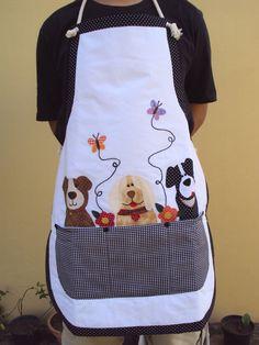 Me encanta la forma de aplicar los perritos como saliendo de la bolsa del delantal, me gusta el diseño para hacerlo en otro color o con motivos de gallinas