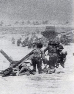 American infantry struggle ashore on Omaha Beach, D-Day June 6th, 1944