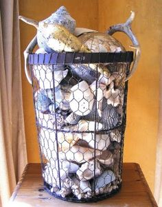 seashells in wire basket (and other ways to display seashells. Good ways to display our NZ shells)