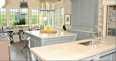 Bobby McAlpine via Cote De Texas--I love the light in this kitchen and the soft color of the cabinets against the brick.