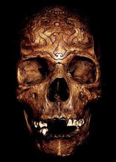 DAYAK CARVED: HEAD HUNTING HUMAN TROPHY #12   HAND CARVED HUMAN BONE  THE DAYAK TRIBE, FROM BORNEO ISLAND  INDONESIA, CARVE DESIGNS INTO THE SKULLS  OF THEIR HEADHUNTED VICTIMS AND INSERT WOODEN FIGURES.