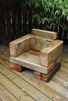 A small garden chair made from softwood timber sleepers. Designed and built by Evoke Landscapes.