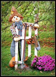 Autumn decor for the yard including an adorable scarecrow!