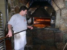 File:Pizza baking in brick oven, New Haven.jpg - Wikimedia Commons