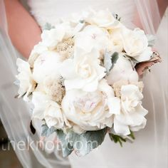 The florist delivered beautifully on Laura's request for a soft white bouquet with a clutch of peonies, gardenia, moss, greenery, and birch bark. The flowers were tied together with a bit of raffia