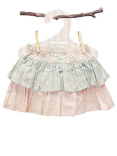This is a super cute baby girl skirt, which regularly becomes a favourite piece of clothing for little girls! It's ideal for summer fun in the garden and park, as well as parties and summer days out with friends. The skirt has a tiered frilly skirt, with layers of pale pink spot, pale blue spot and a classic damask print.