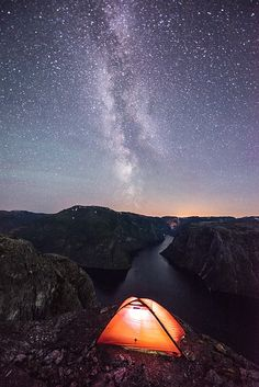 Campsite at Kalvsnesnosi above the Aurlandsfjord and Nærøyfjord with the Milky way above (Norway), by Espen Haagensen via 500px