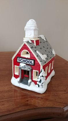 Plaster village school house.  I got water in my basement and accidently threw away the bell tower during the cleanup.  But I was able to find a clock tower that fits on top at a plaster shop online.  Just need to paint it.