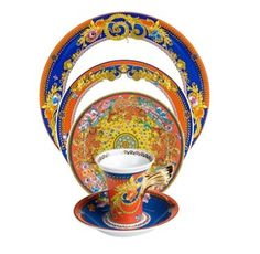 Versace tea cup helps us enjoy our tea and our talk is easy and smooth.