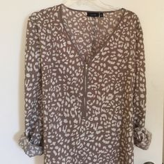 Taupe animal print blouse zip up blouse NWOT Soft long sleeve animal print top with silver zipper and Vneck. Never worn and is machine washable . Size XL Apt. 9 Tops Blouses