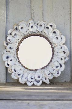 Small Round Oyster Shell Mirror: Eccentric and out of this world for any uniquely styled home. Add a touch of flair to your living room, bedroom, or even beach-house! #ExpensiveHomeDecor #MirrorDecorations #WallDecor
