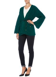 This chunky cable knit cardigan is an essential staple for when the temperature begins to dip. With kimono sleeves and a belted waist, this piece is perfect for layering over dresses. Dark green kimono cable belted cardigan Cable knit Kimono sleeves Open front Belted waist Model's height is 5'11