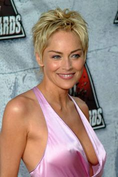 Sharon stone taking off her top to bare her breasts free