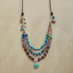 COAST LINES NECKLACE - In this amazonite drop and gemstone necklace, turquoise, amethyst, garnet and teal-dyed jade tumble like waves as a faceted drop of amazonite, framed in sterling silver, washes ashore. Thai silver beads, with adjustable leather cord.