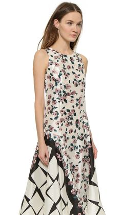 The trick to blending prints? Find a common theme in both, like the black and cream colors in this dress.  #fashion