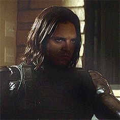 It's so dark in the movie that you really can't see all of the Winter Soldier's face (bless whoever lightened this gif up!). However, this is Seb's Winter Soldier face: expressionless and cold. His brainwashed face to be exact.This is the first time we see his face unmasked on a mission since he lost his mask. And yet, the shadows still serve as a mask. He remains a ghost, his identity hidden in the darkness. I have no doubt that he knows exactly where to sit so the shadows conceal his…