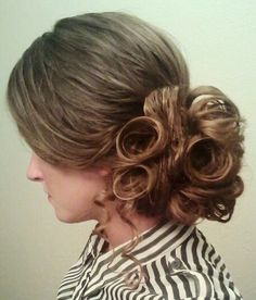 swoop im the front with rolls and curls in the back, on the side. ;)